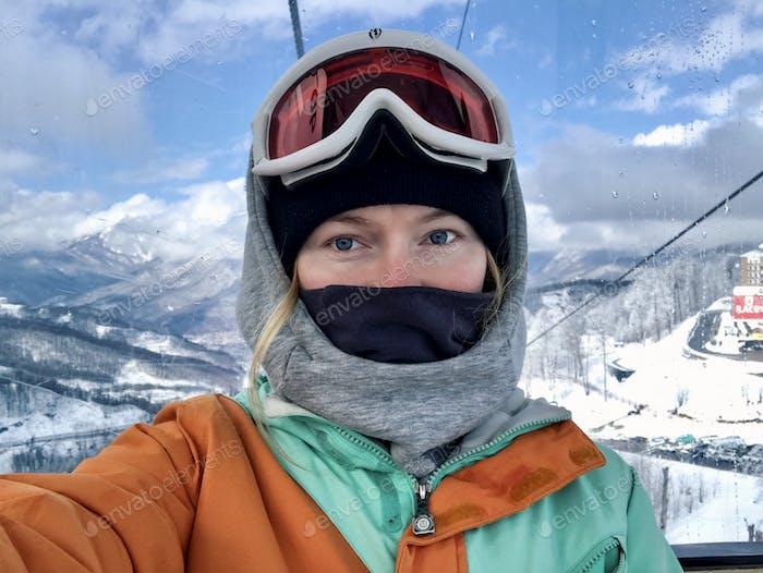 Selfie in snowboard wear