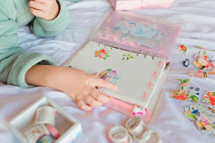Kid making handmade scrapbook