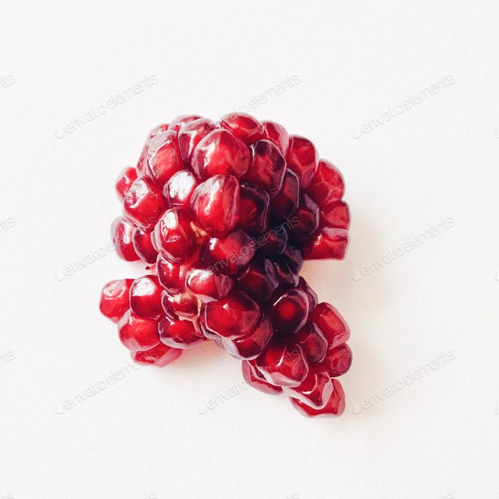 Part of pomegranate on white background