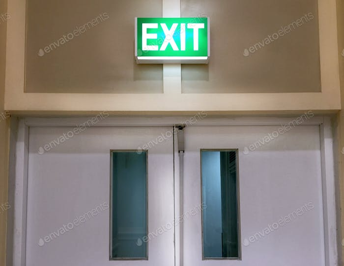Closed Door with Glowing Emergency Exit Label