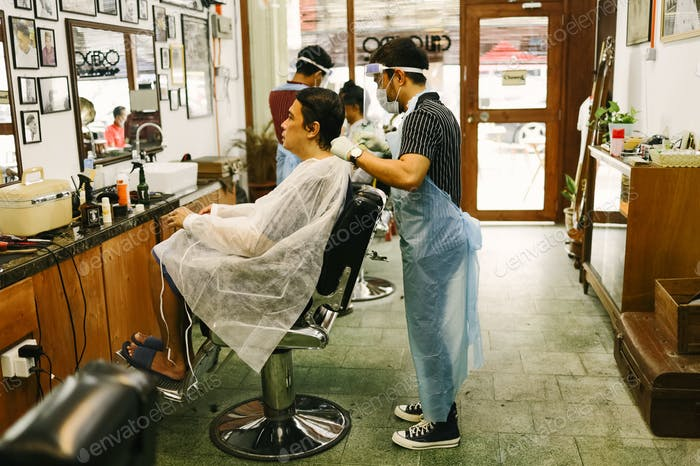 New Normal at barber shop A barbers apply new normal in his barber shop