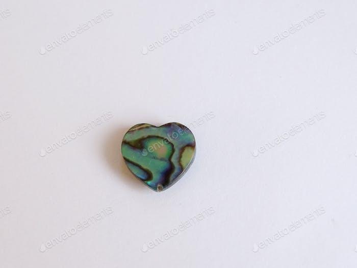 Green gemstone in heartshape