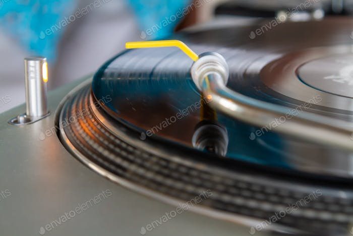 Hifi turntable music player close up. Audio equipment for playing old analog vinyl records.