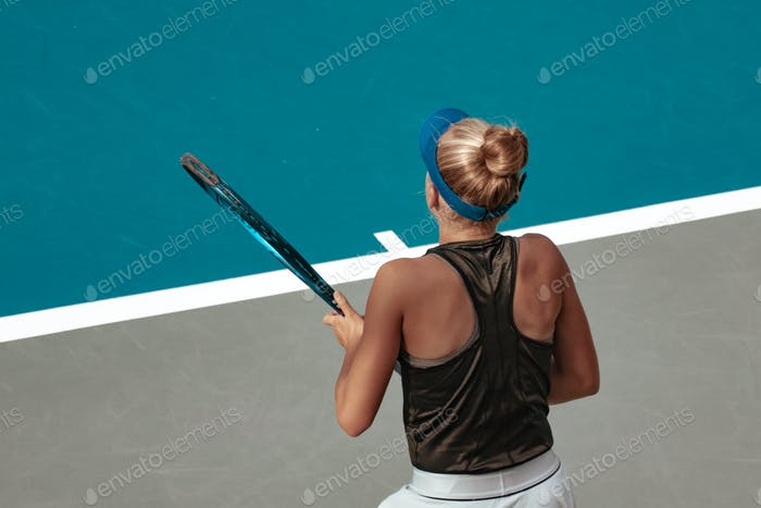female tennis player, competitive sport, action shot, tennis court