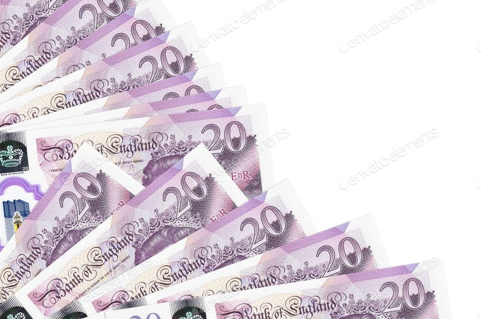 20 British pounds bills lies isolated on white background with copy space stacked in fan close up