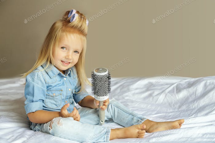 ⭐️⭐️⭐️ Nominated ⭐️⭐️⭐️ cute little girl with white hair in hair curlers stays at home on the bed