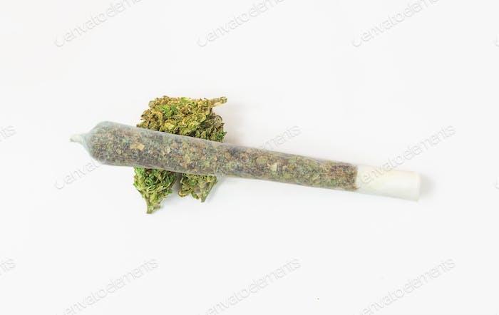 Marijuana joint isolated on white