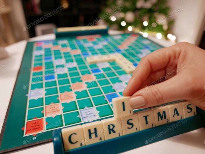 Scrabble board game on table. Winter holidays, christmas, december.