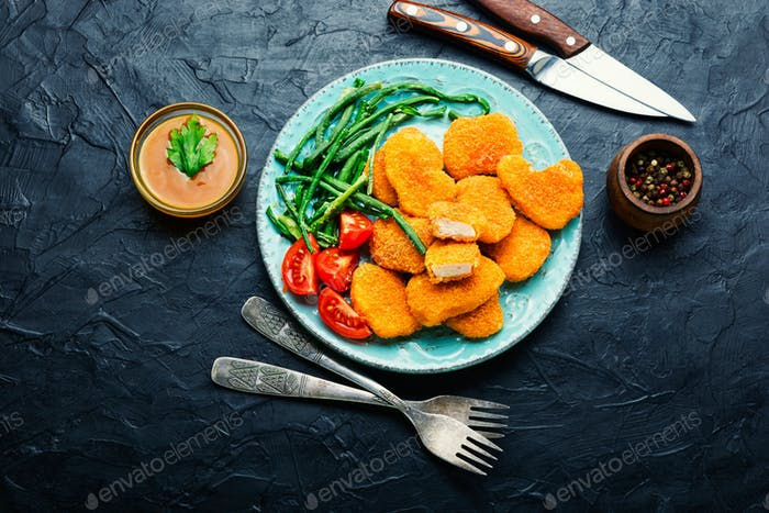 Nuggets with vegetable garnish