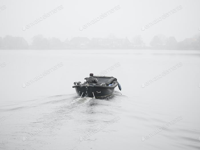 Boating on a foggy morning