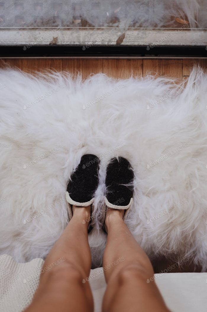Cozy slippers on a sheepskin right