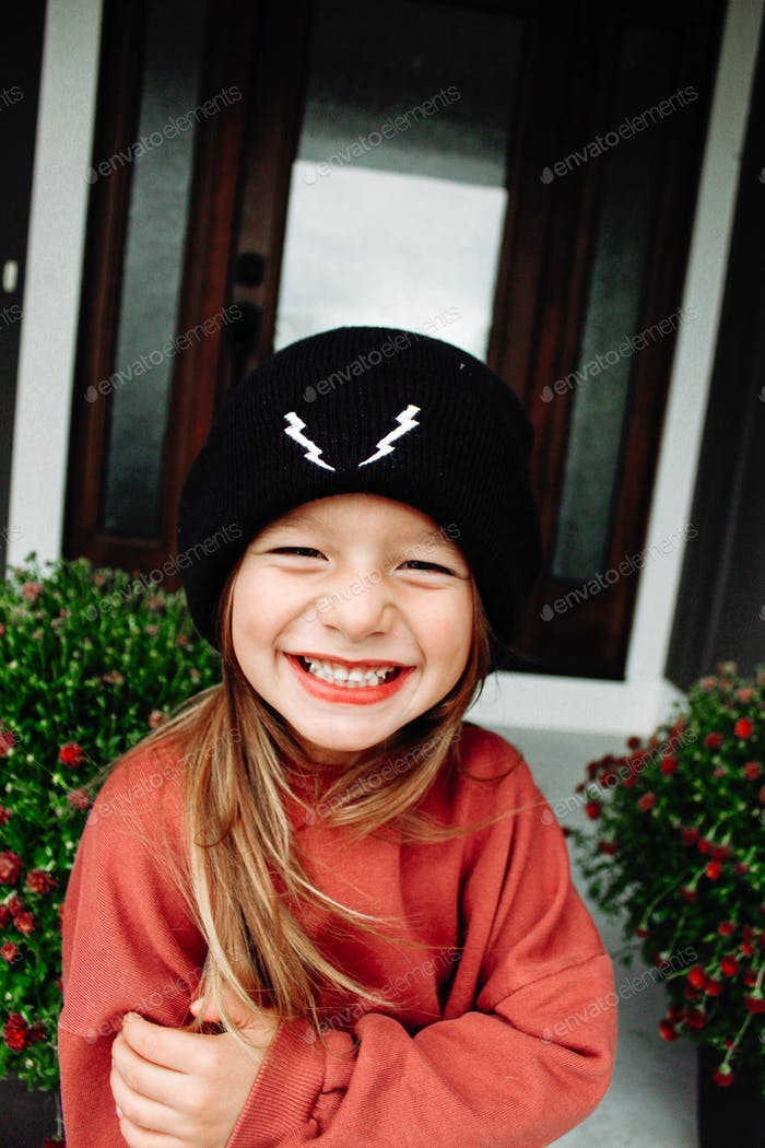 Girl wearing a beanie laughing