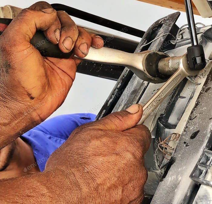 Mechanic working with wrenches on an engine Occupation Work Closeup Hands Hard work Nominated💪🏼