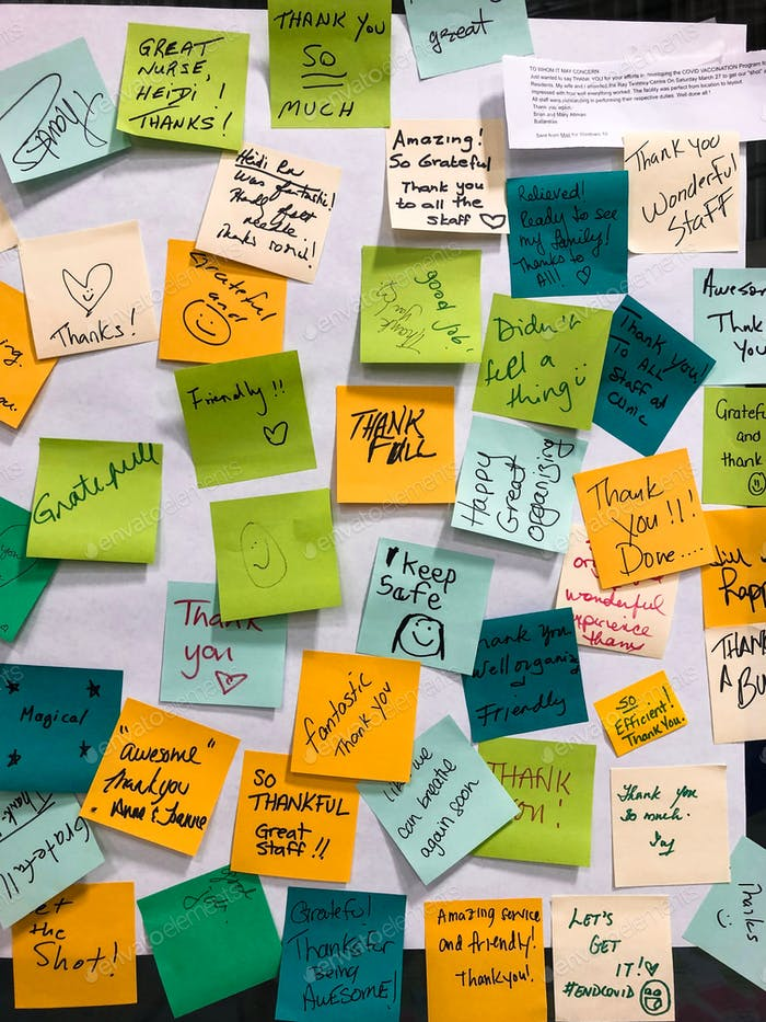 Thank you sticky notes from patients who received COVID-19 vaccine
