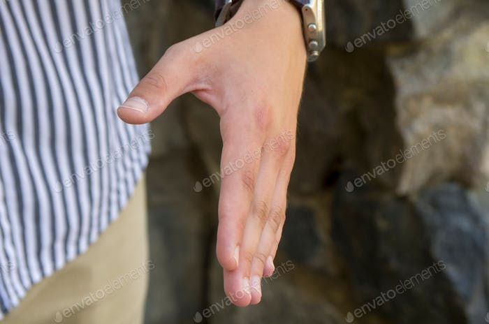 male hand extended for handshake
