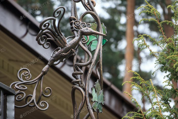 decorative wrought firebird - the design of a country house