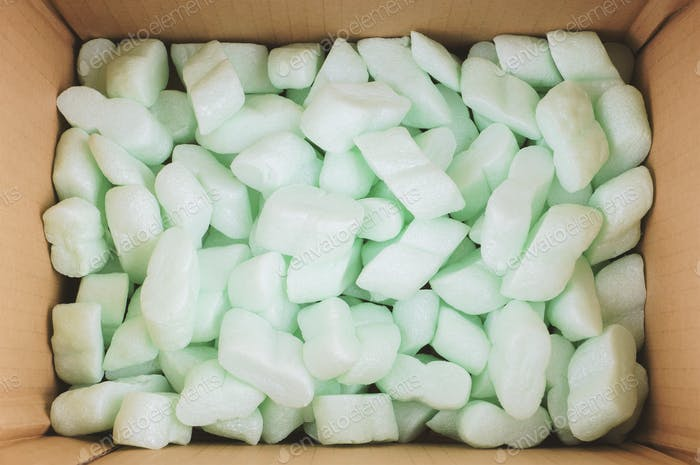 cardboard box filled with polystyrene foam peanuts packaging filler cushioning material