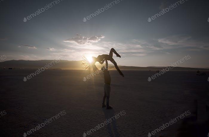 Burning man sunset acro