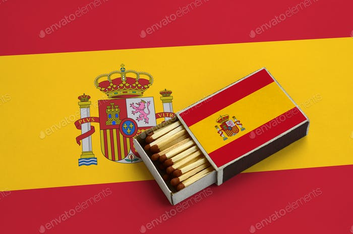 Spain flag  is shown in an open matchbox, which is filled with matches and lies on a large flag.