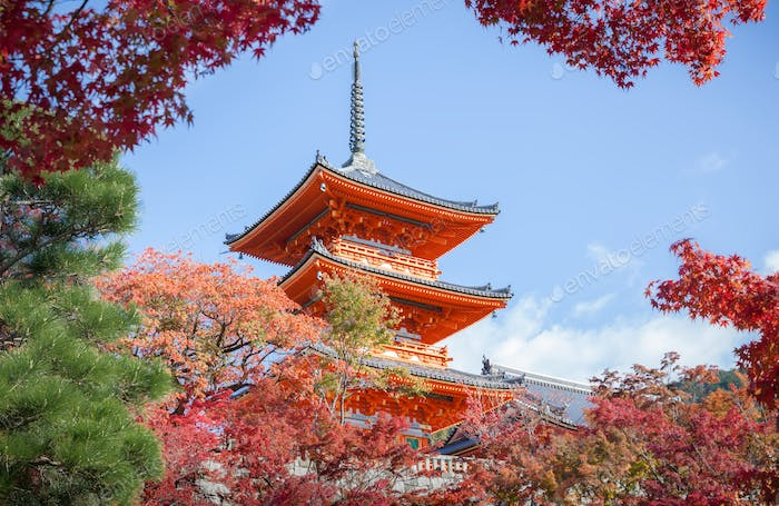Three-story pagoda in Kiyomizu-dera temple and fall foliage.