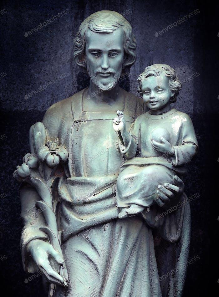 Statue of Joseph with Jesus as a child, faith, religion