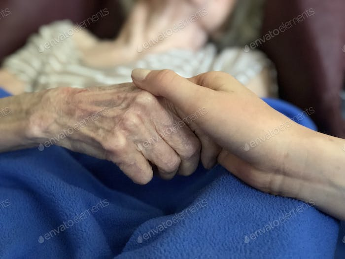 Young and old holding hands… Crossing the generations