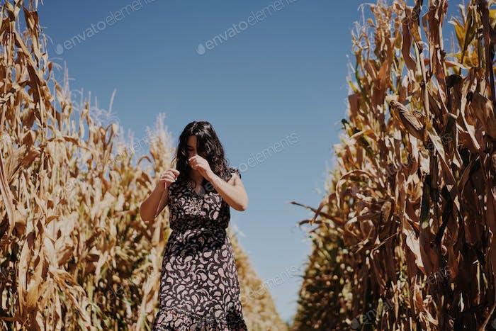 Woman in cornfield in daylight