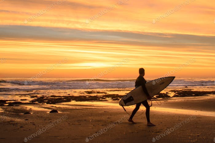 Surfer watching the sunset