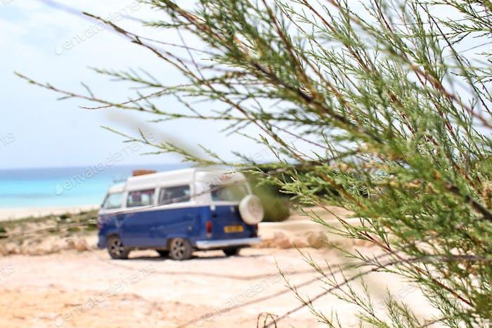 Camper van parked by a beach