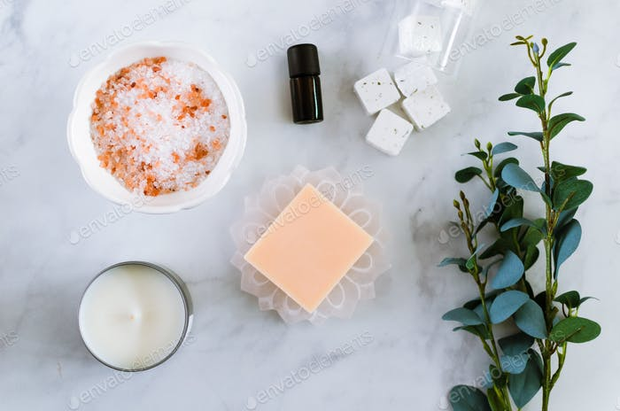 Overhead flat lay of self care, spa day, relaxation bath items