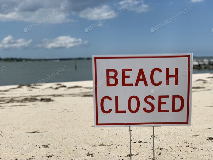 Beach closed sign during Covid19 pandemic as a  measure to contain the spread of Covid19.