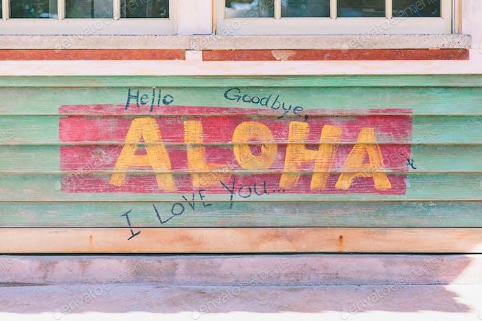 A painted sign saying aloha