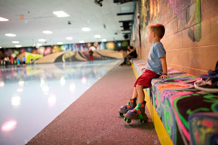 Family roller skating at a neon roller rink