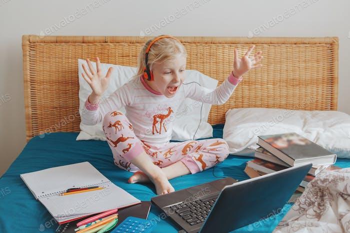 girl; child; education; class; home; learn; online; Internet; happy; like; school; virtual; laptop;