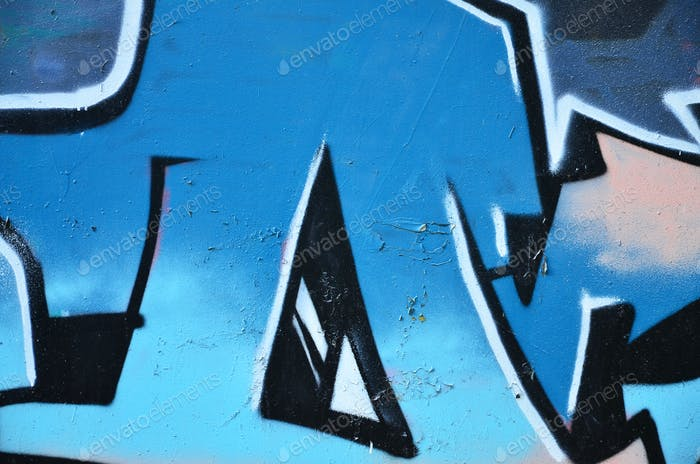The old wall, painted in color graffiti drawing blue aerosol paints