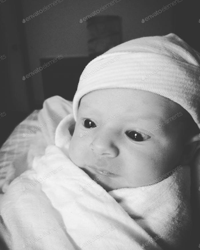 Newborn baby wearing a beanie