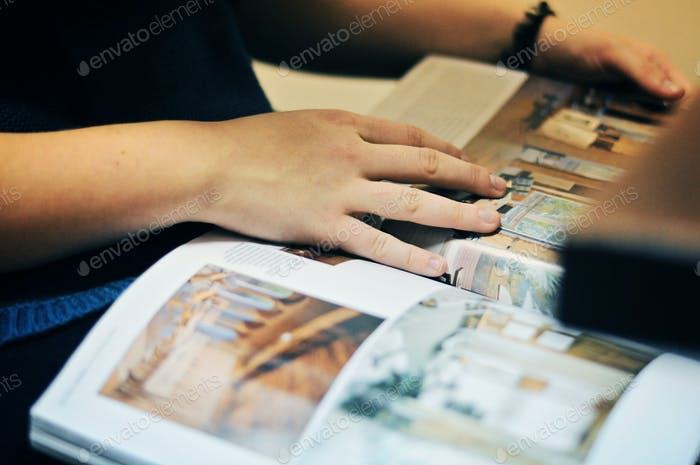 hands and journal / magazine