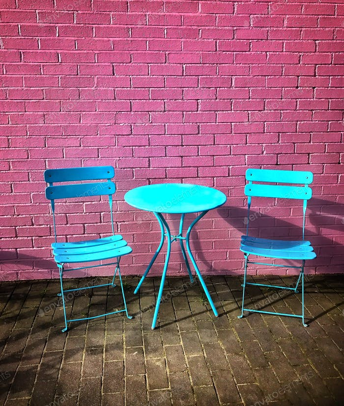 Bistro Table & Chairs ~ pink brick wall background with pastel blue chairs and shadows on the wall