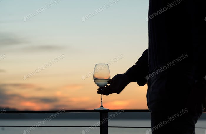 Outdoor entertaining at sunset with wine