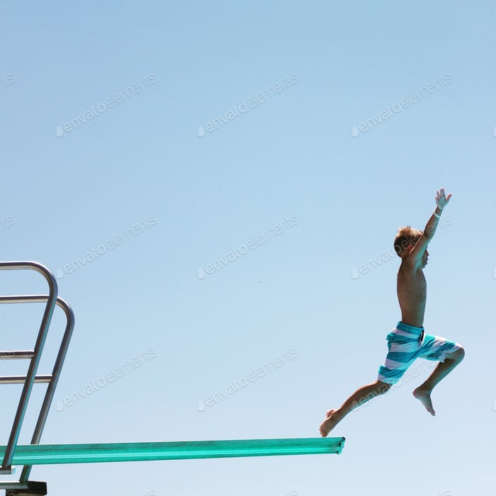 Boy on a diving board at the pool