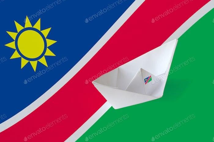 Namibia flag depicted on paper origami ship closeup. Oriental handmade arts concept