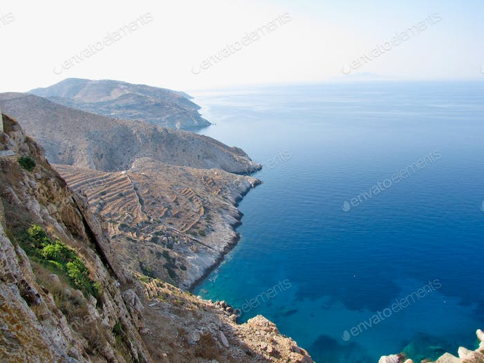 A stunning view of terraced land against the Aegean Sea.