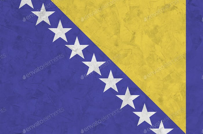 Bosnia and Herzegovina flag depicted in bright paint colors on old relief plastering wall close up