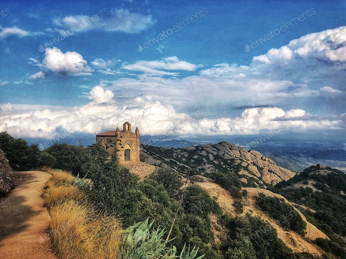 ✨NOMINATED✨ A small chapel on top of one of the cliffs of the Montserrat mountain in the background