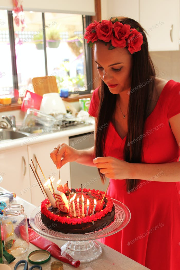 Lighting the candles on mum's cake