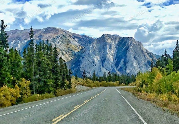 Open road through the stunningly beautiful Canadian Yukon Territory
