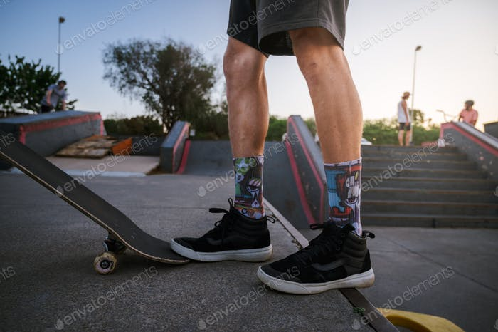 Skateboarder at a skate park with trendy sneaker fashion and socks
