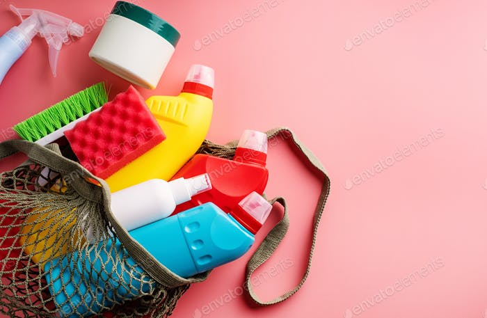 Cleaning products and housekeeping. Sanitary bottles and cleaning tools in eco-friendly mesh bag on