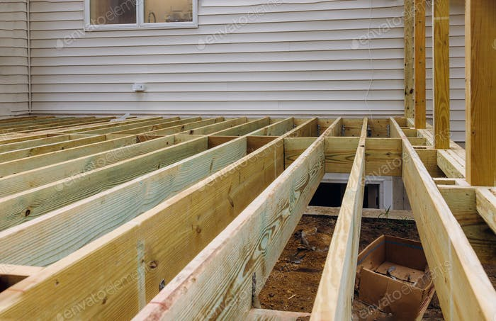 Installing deck patio construction. boards with above ground deck