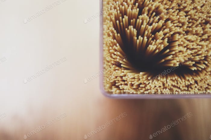 Close up of uncooked spaghetti noodles.